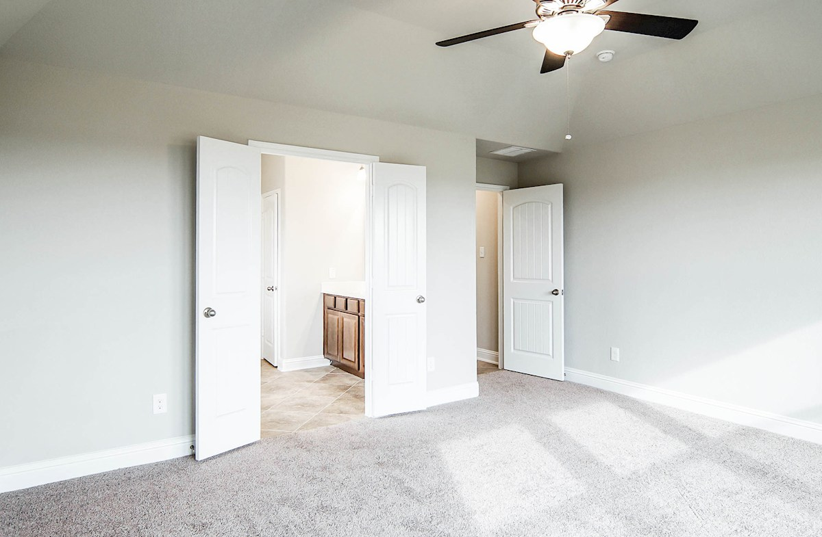 Madison quick move-in master bedroom with ceiling fan and carpet