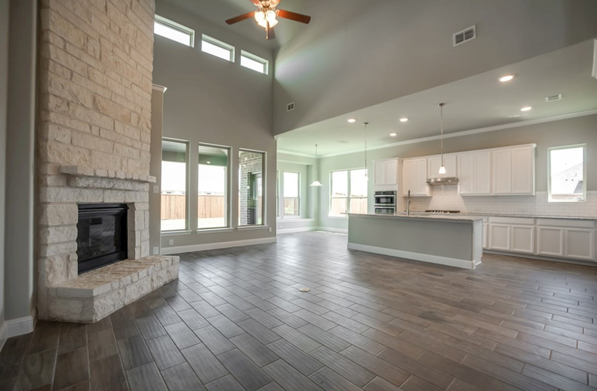 Summerfield quick move-in open great room with stone fireplace and soaring ceilings
