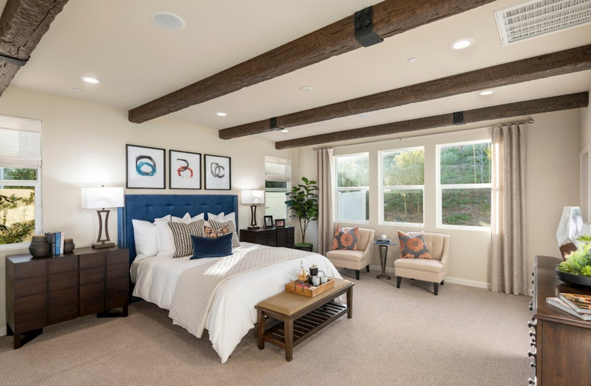 Aurora Heights Cedar relax in the bright, spacious master bedroom