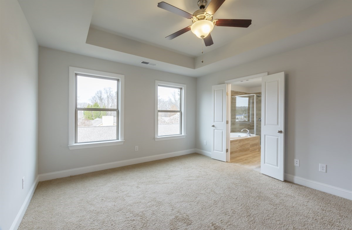 Piedmont quick move-in Master Bedroom with ceiling fan
