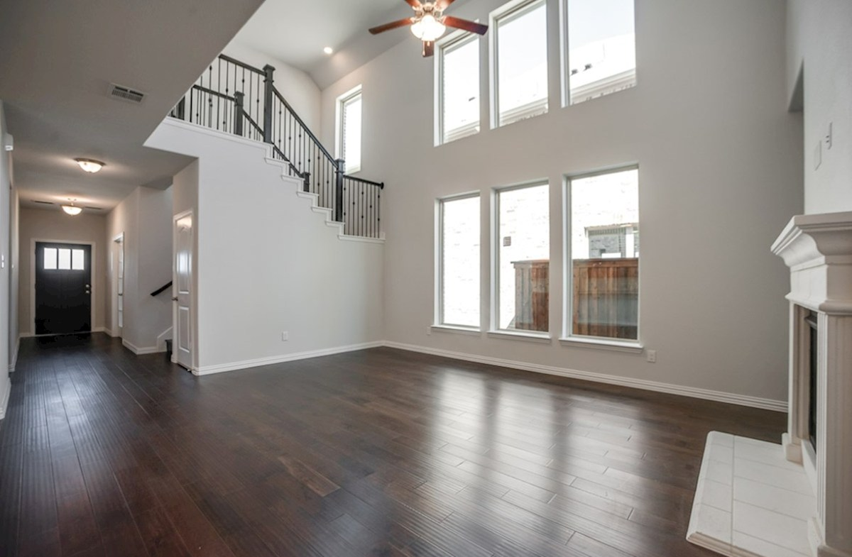 Whitney quick move-in open great room with wood floors and windows