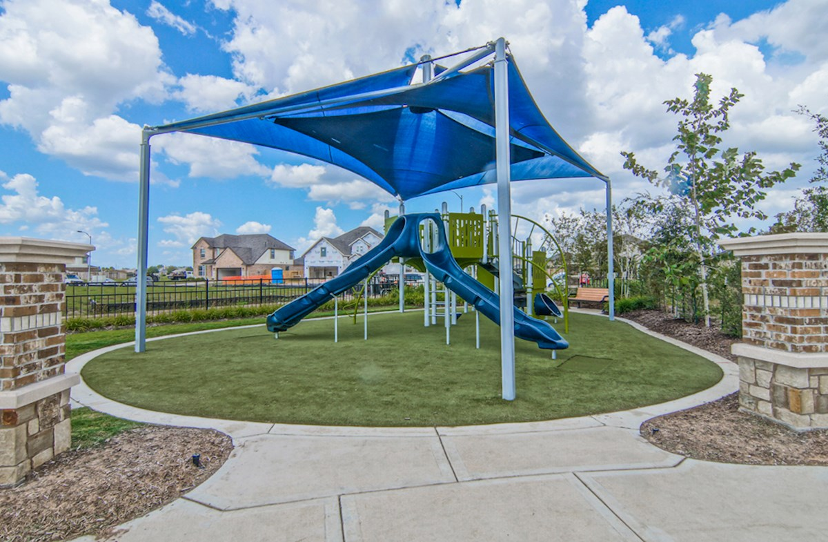 Community playground includes slide and shade