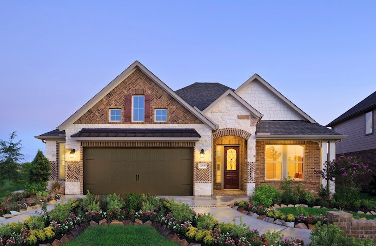 Cameron French country exterior with stone accents