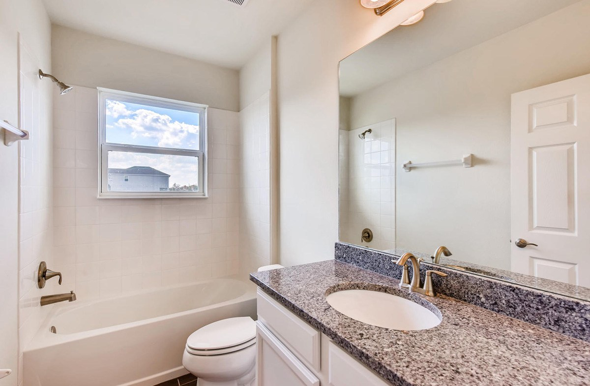 Avalon Park West Redington Bathroom with granite counters