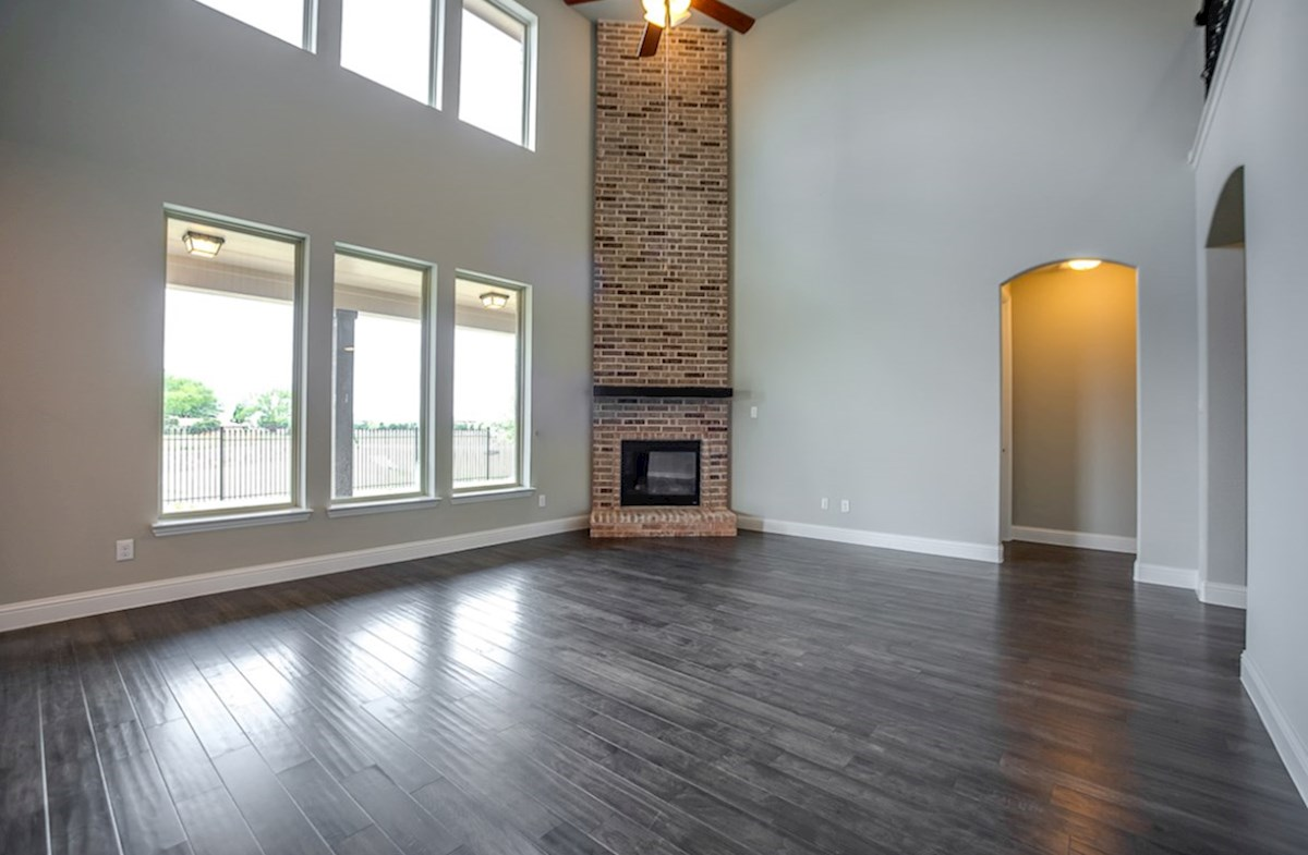 Trinity quick move-in great room with brick fireplace and wall of windows