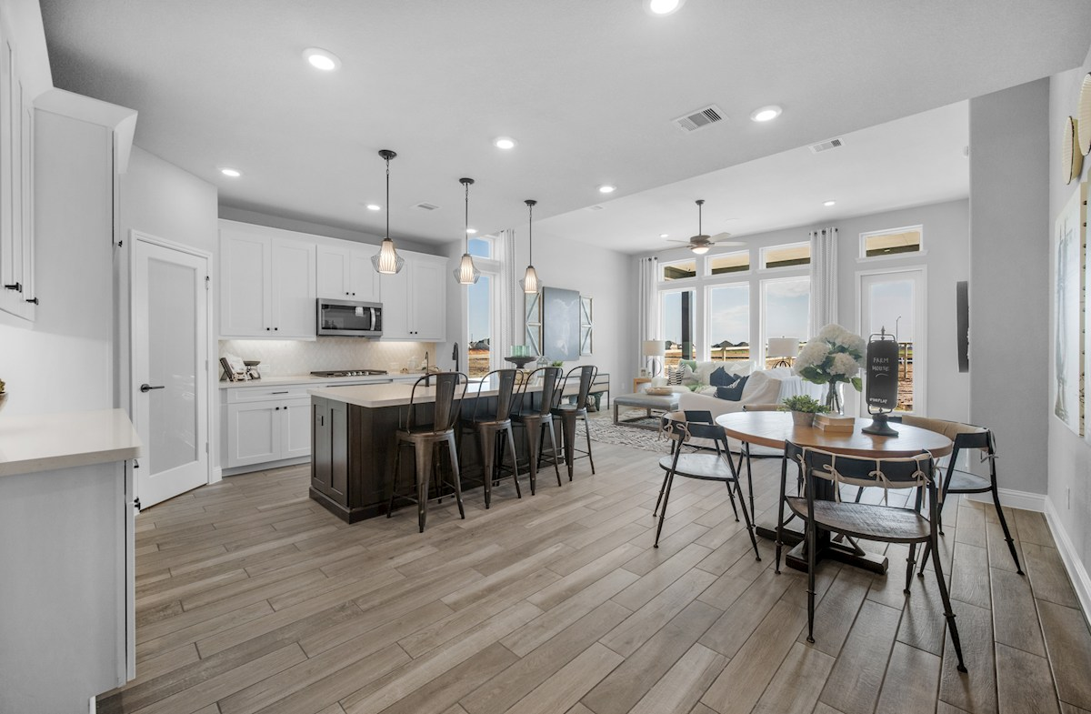 kitchen with large island and pendant lighting
