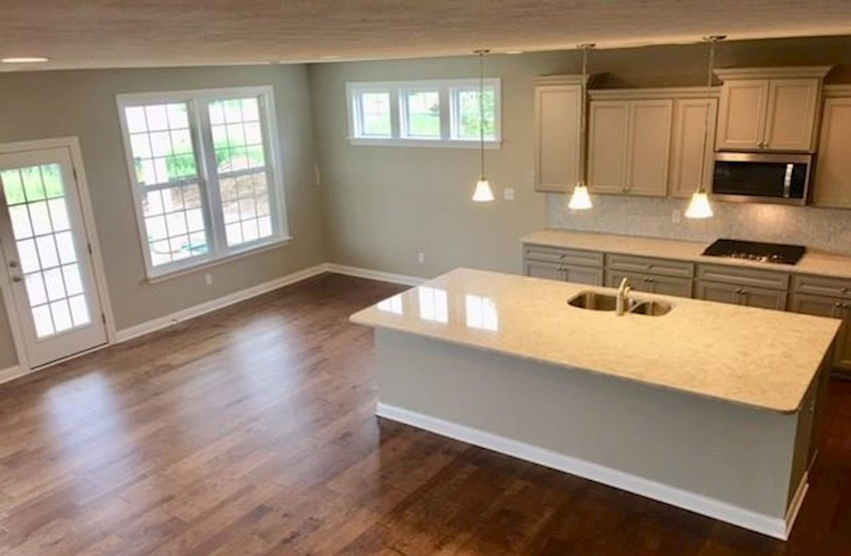 Windsor quick move-in Kitchen has large island for casual dining