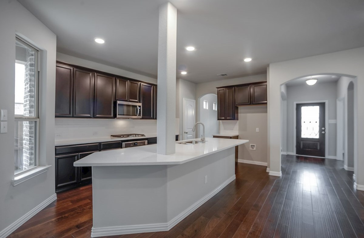 Eastland quick move-in open kitchen with dark cabinets