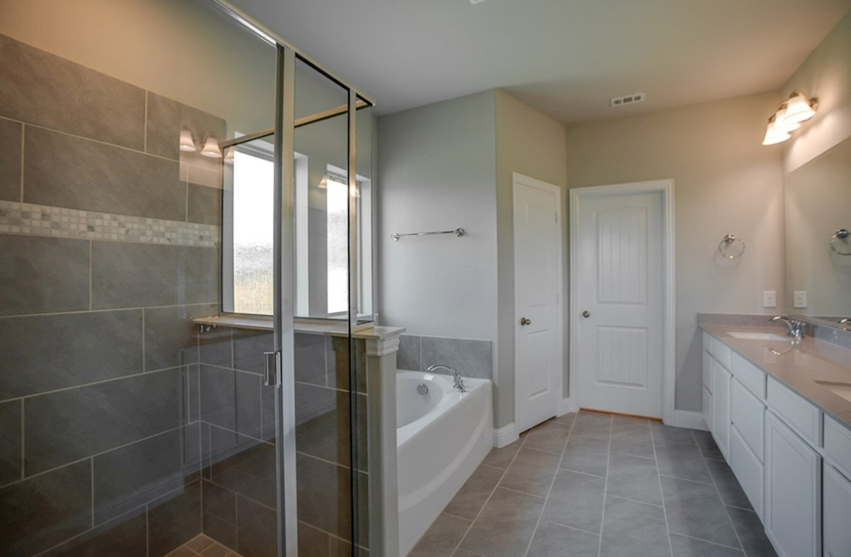 Brookhaven quick move-in master bath includes walk-in shower and separate tub