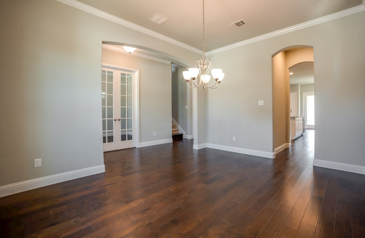 Whitney quick move-in formal dining room includes wood flooring