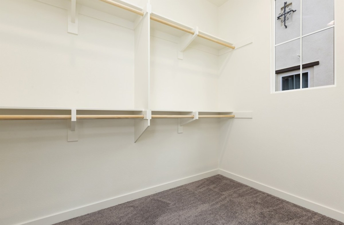 Pinyon quick move-in Walk-in closet is designed for easy movement between shelves and optimal hanging and storage space