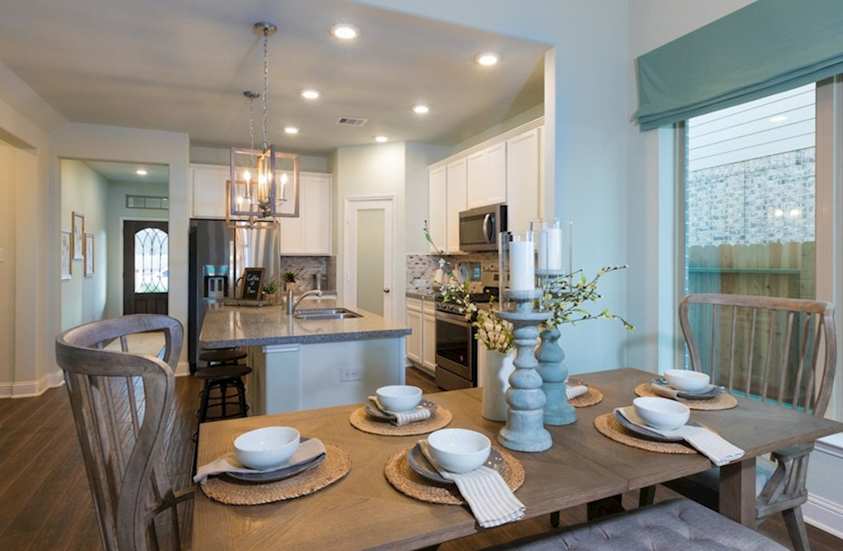 Amira  Alder  kitchen with granite island and tile floors