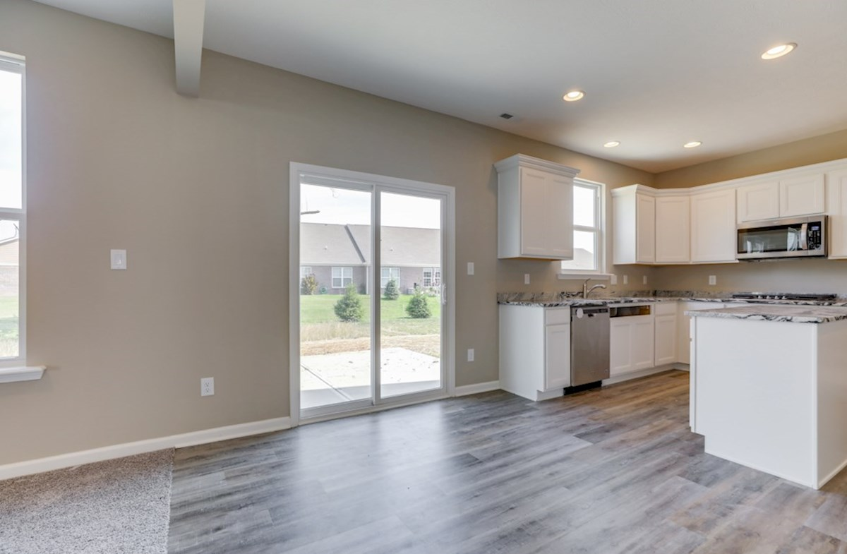 Juniper quick move-in breakfast area with laminate hardwood floors