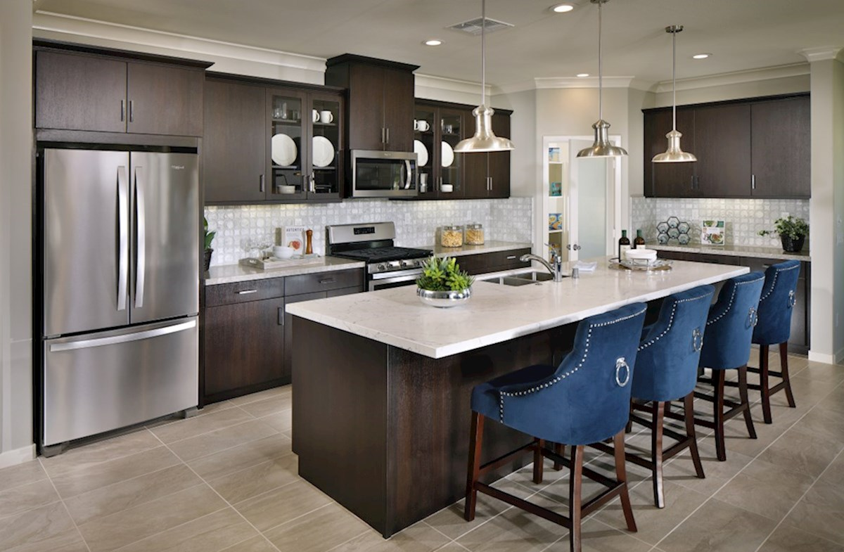 Provence at Heritage Ranch Napa The kitchen features spacious countertops and a walk-in pantry to maximize storage.