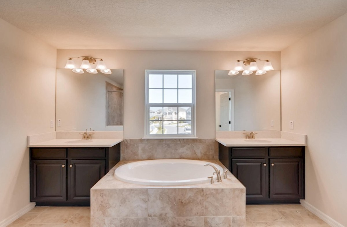 Sequoia quick move-in Master bathroom with two vanities and a garden tub