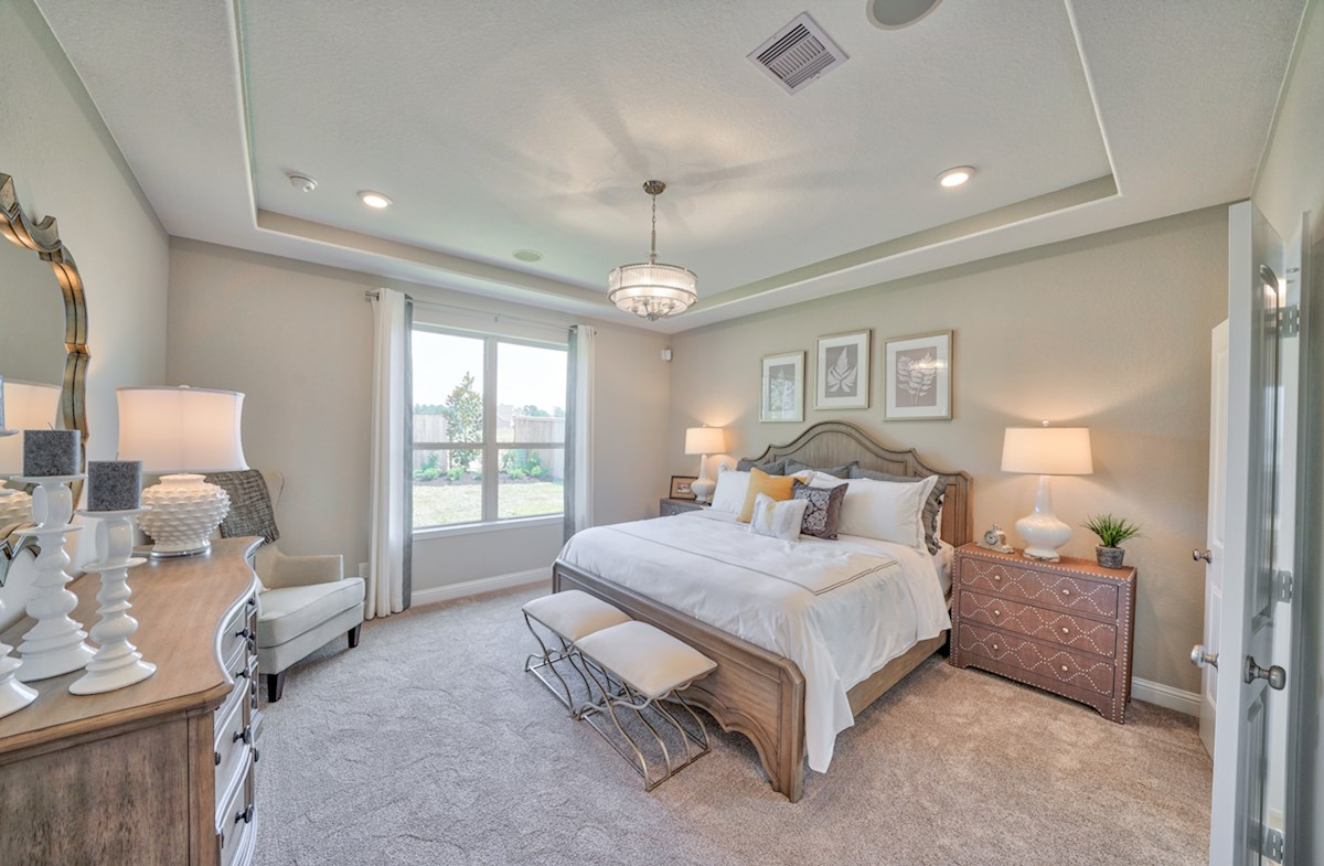 Armstrong master bedroom offers tray ceilings