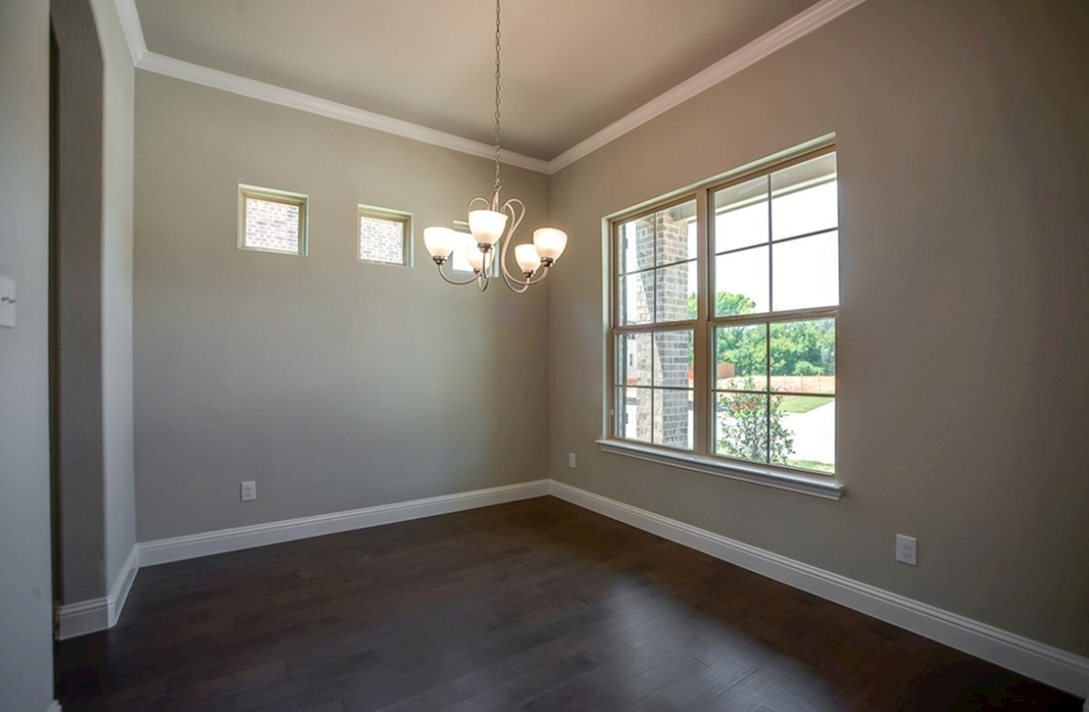 Hamilton quick move-in dining room with windows and wood floors