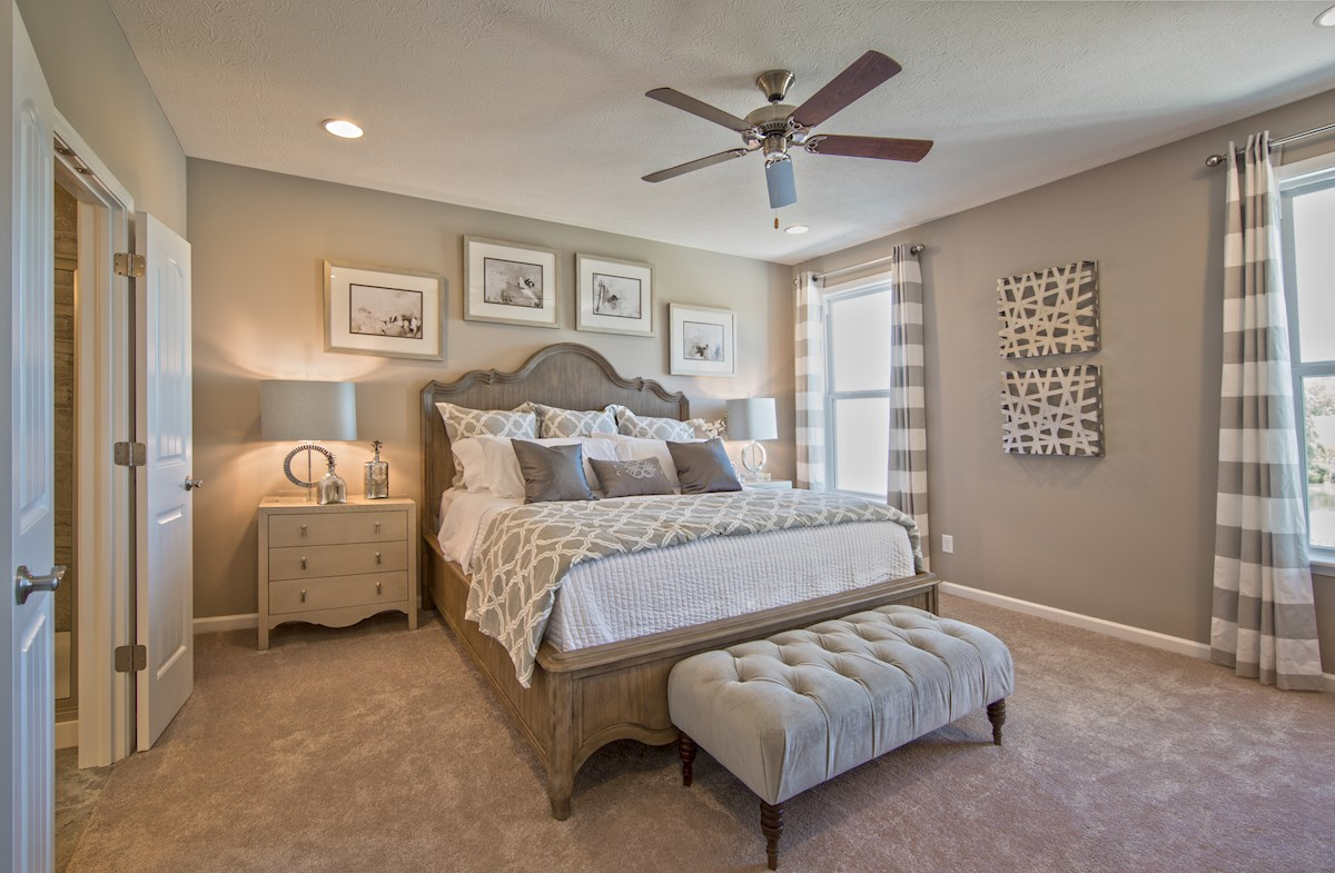 master bedroom with carpet and ceiling fan