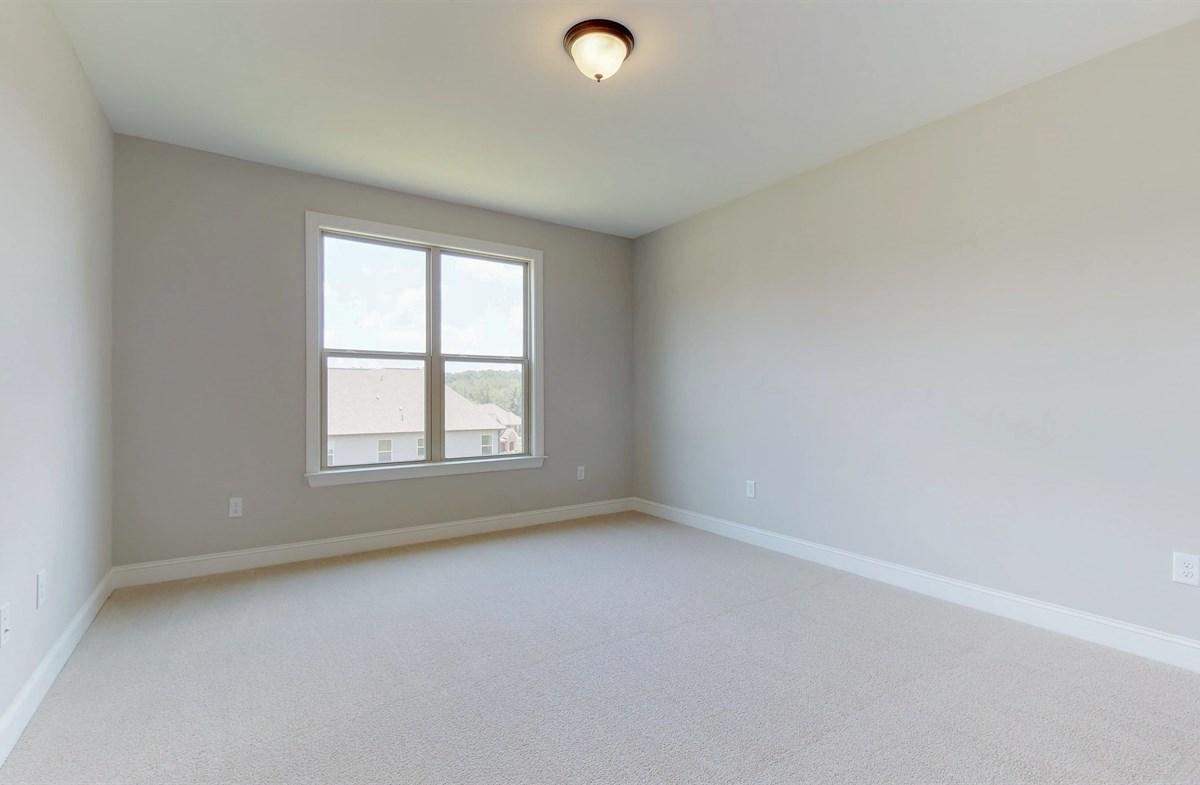 Tara quick move-in Main Floor Secondary Bedroom