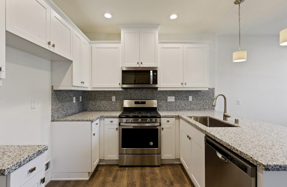 Foxtail quick move-in Gourmet kitchen boasts an oversized island, stainless steel appliances, and stunning granite countertops