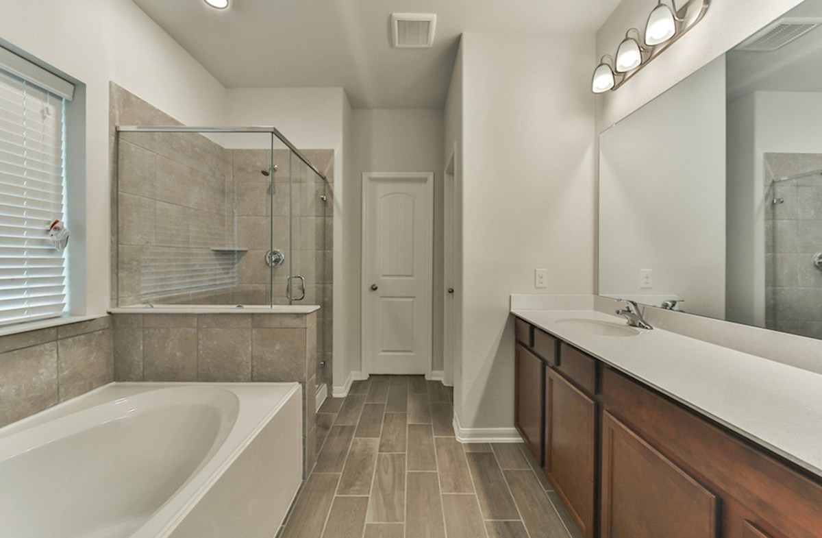 Franklin quick move-in master bath with tile flooring, garden tub and separate shower