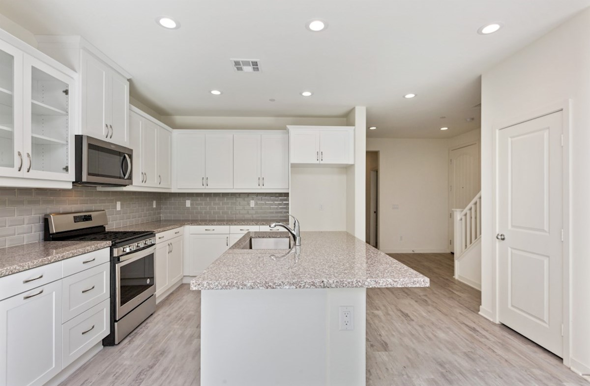 Suncup quick move-in The kitchen island is the perfect place for serving and lingering over the day's events