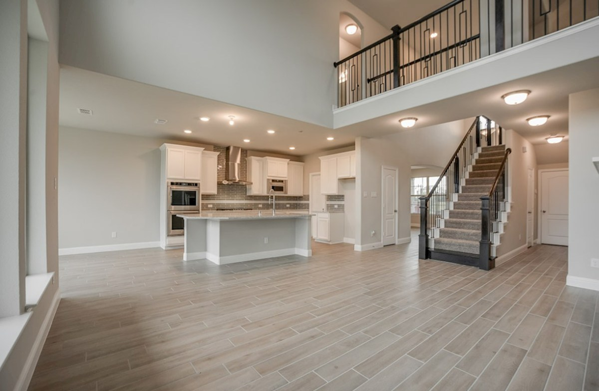 Aberdeen quick move-in Aberdeen great room with wood flooring and grand staircase