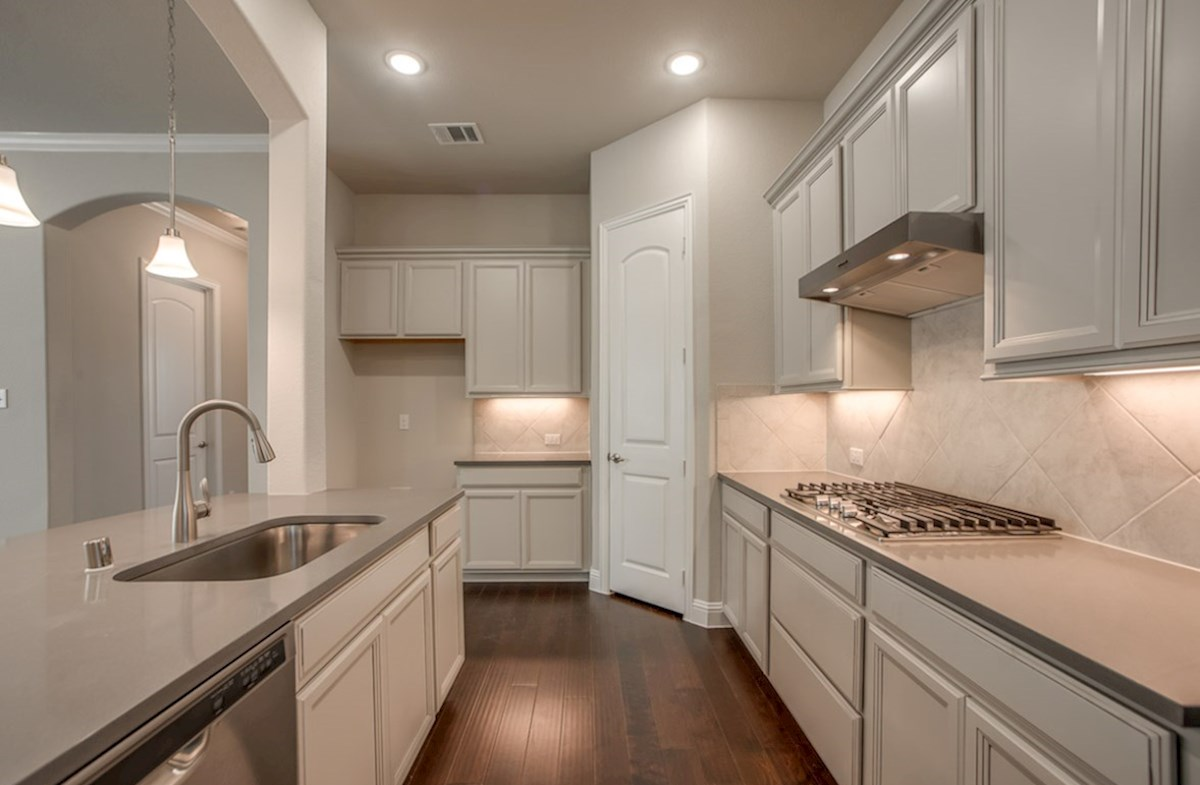 Eastland quick move-in open great room and kitchen with wood floors