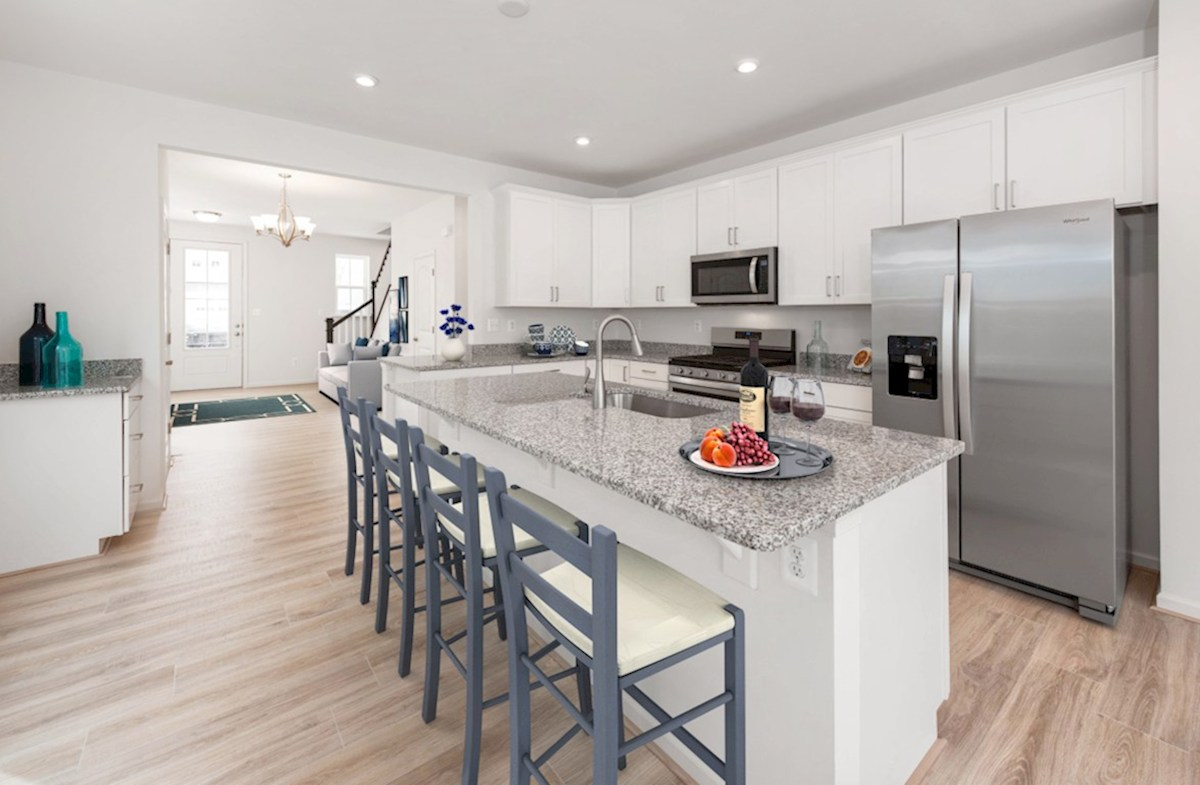 Heron's Ridge at Bayside Dover Open Dover kitchen featuring stainless steel appliances