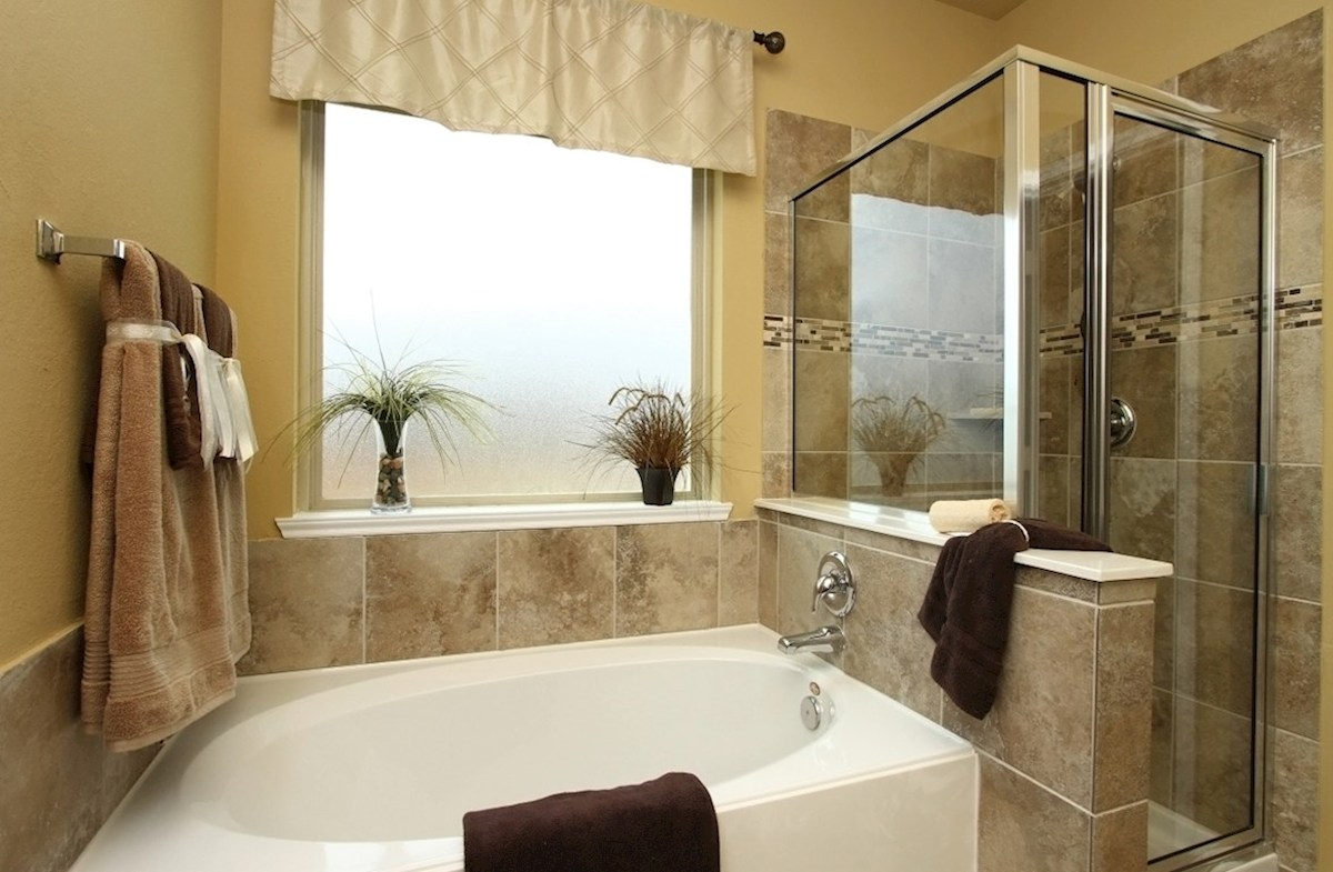 Villages at Harmony Maddox master bathroom with tile flooring