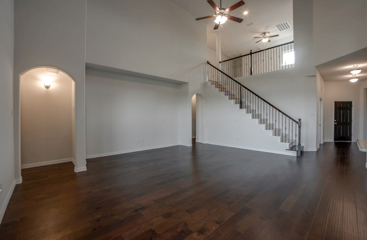 Kerrville quick move-in great room with wood flooring