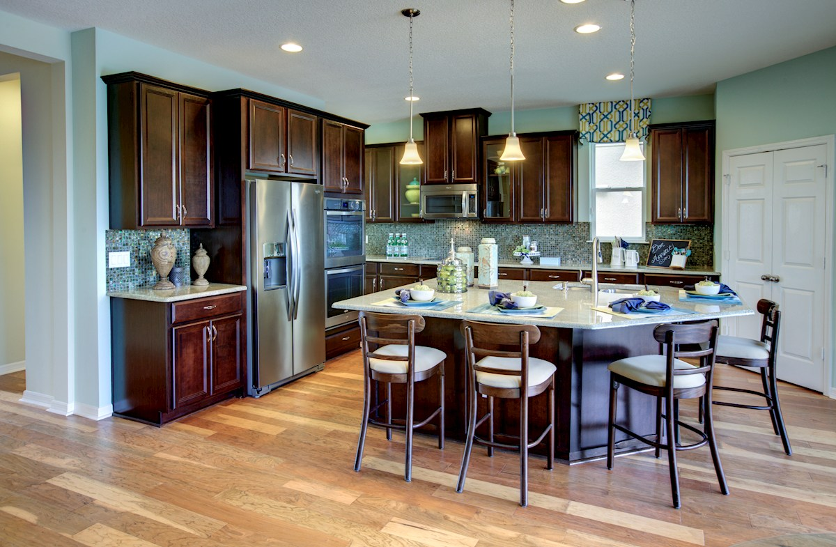 "The Reserve at Pradera Anna Maria Kitchen with 42"" cabinets and center island"
