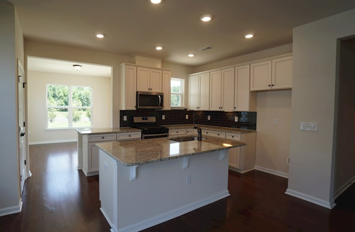 Lexington quick move-in kitchen features hardwoods and granite countertops