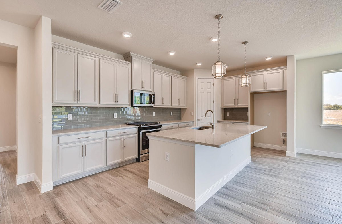 Bayview quick move-in Open kitchen with tiled backsplash