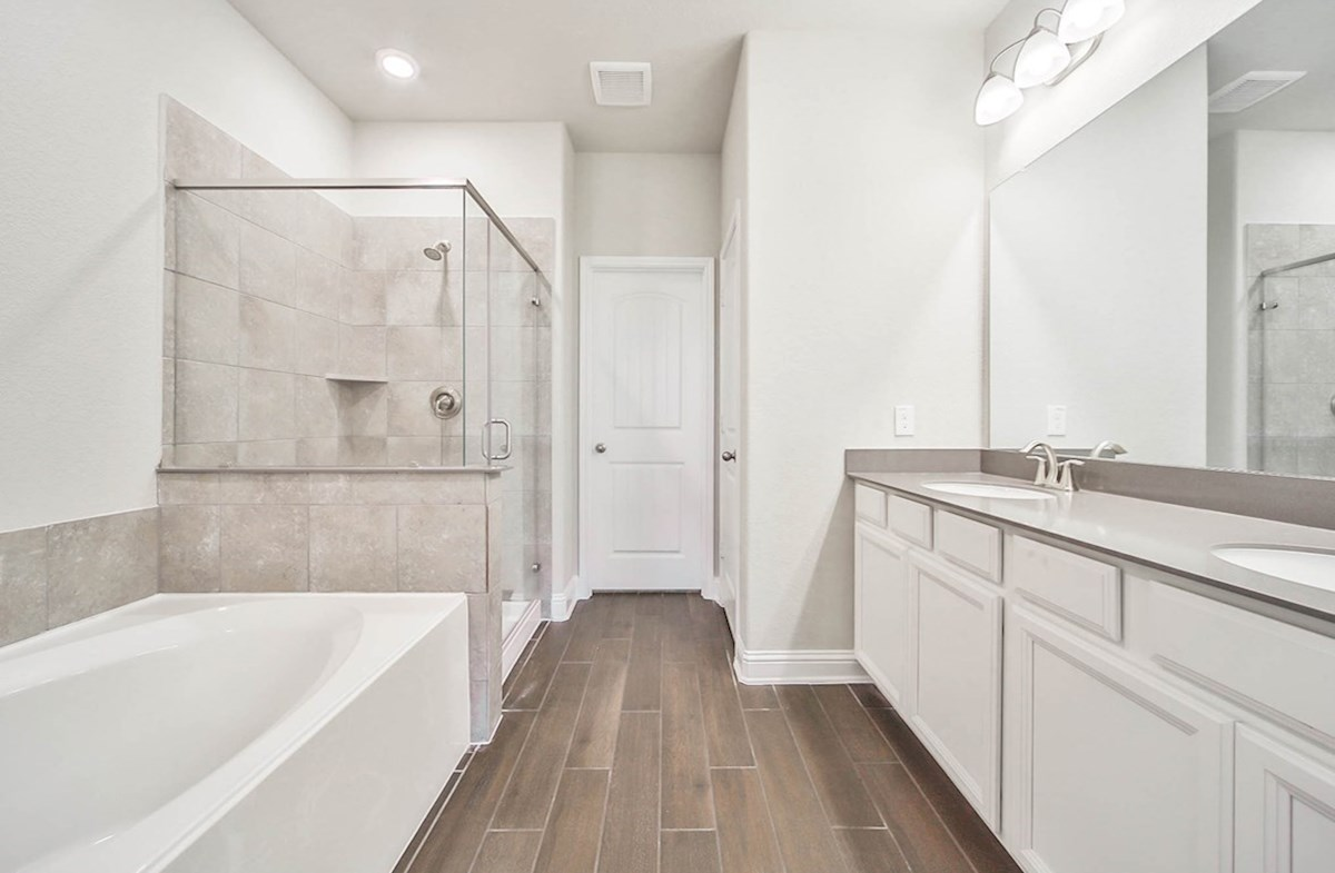 Magnolia quick move-in modern master bathroom with silestone countertops