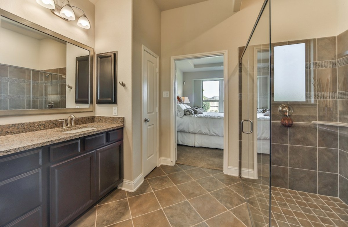 Cameron quick move-in master bathroom with tile flooring