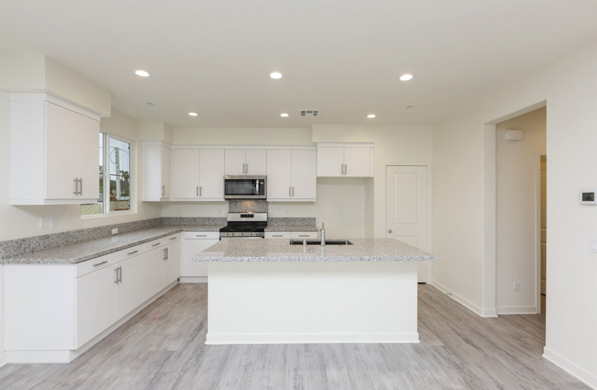 Pinyon quick move-in Granite countertops and center island with sink provide the ideal location for food preparation