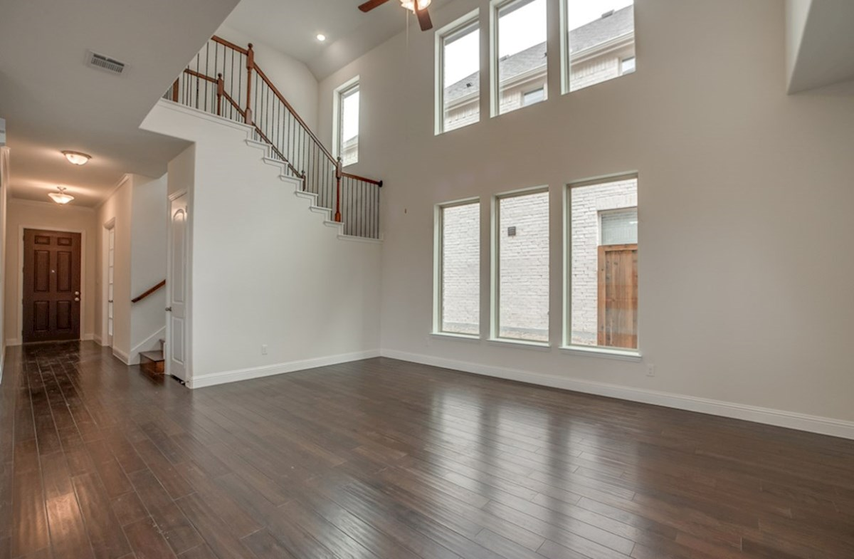 Whitney quick move-in open great room with wood floors and tall ceilings