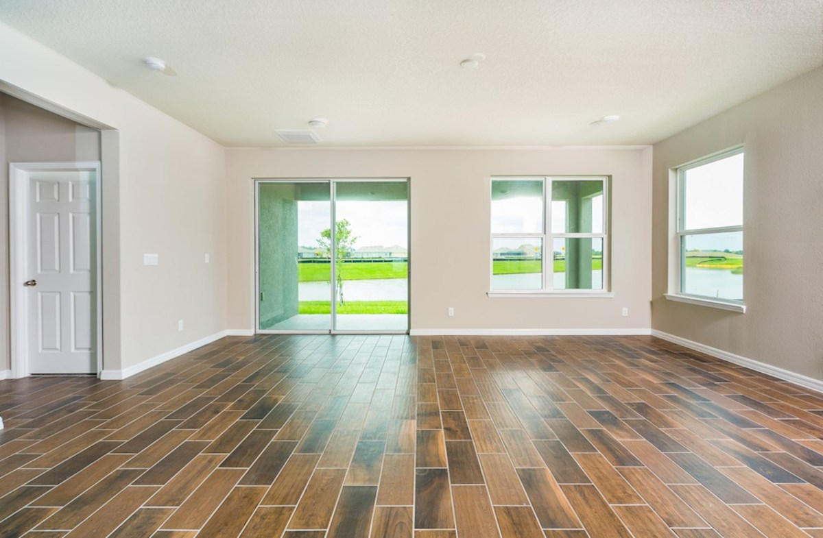 Redwood quick move-in Great room featuring large slider for pond views and lanai access
