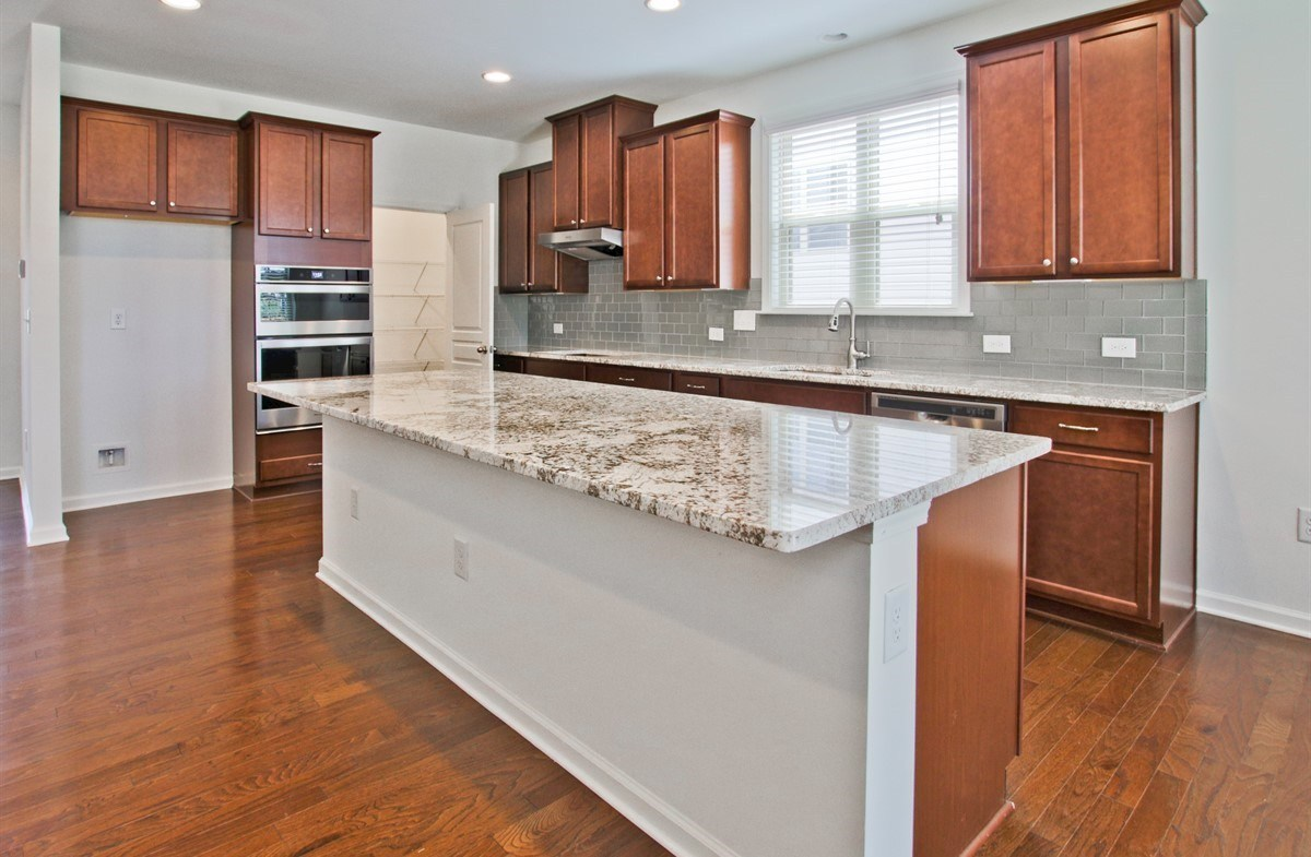 Laurel quick move-in Kitchen with large granite island