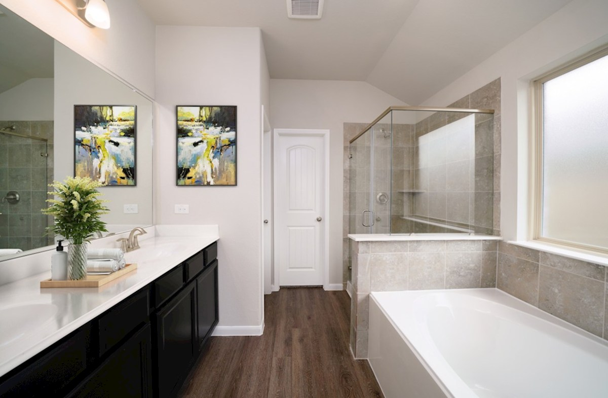 Lantana Sierra master bathroom with separate tub and shower