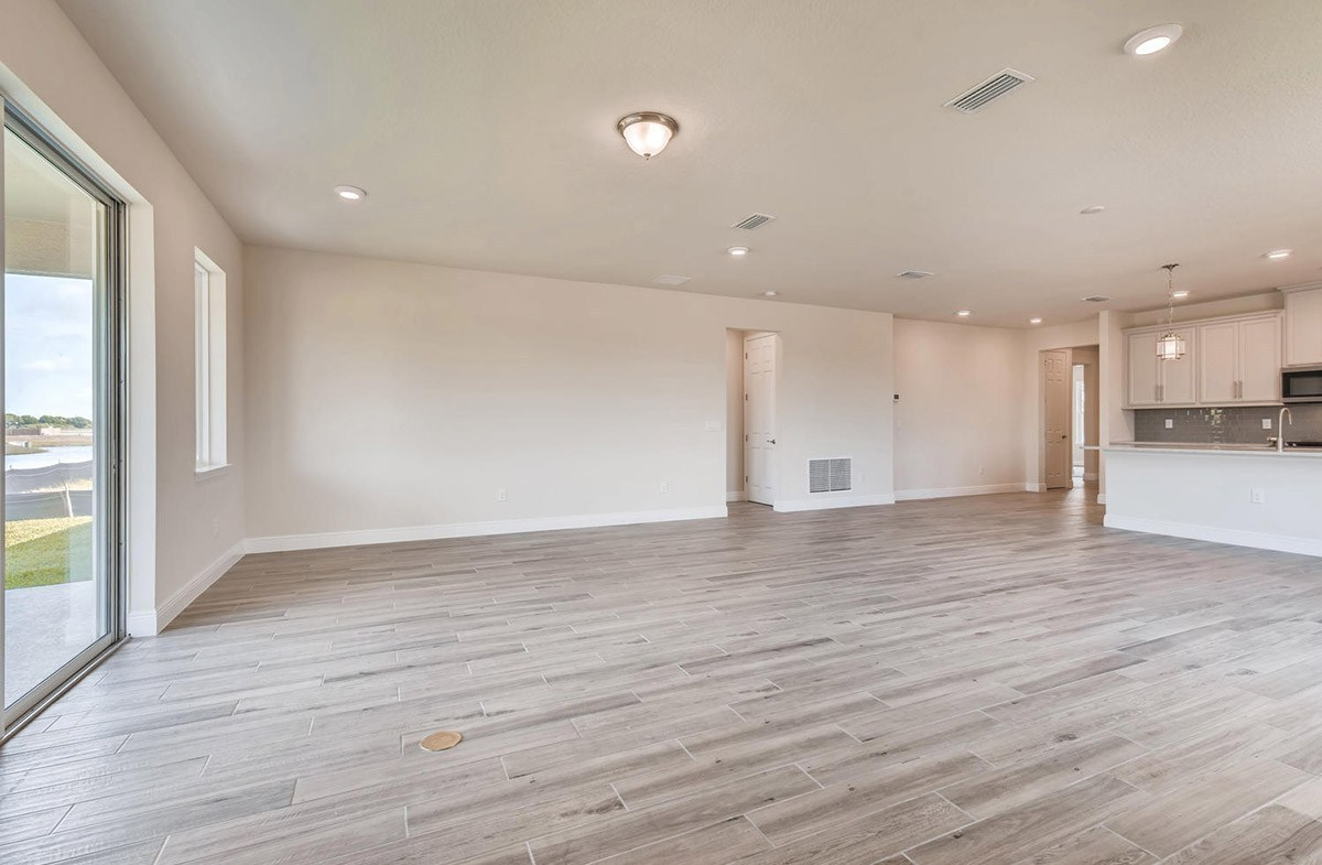 Bayview quick move-in Great room and dining room with wood-look tile