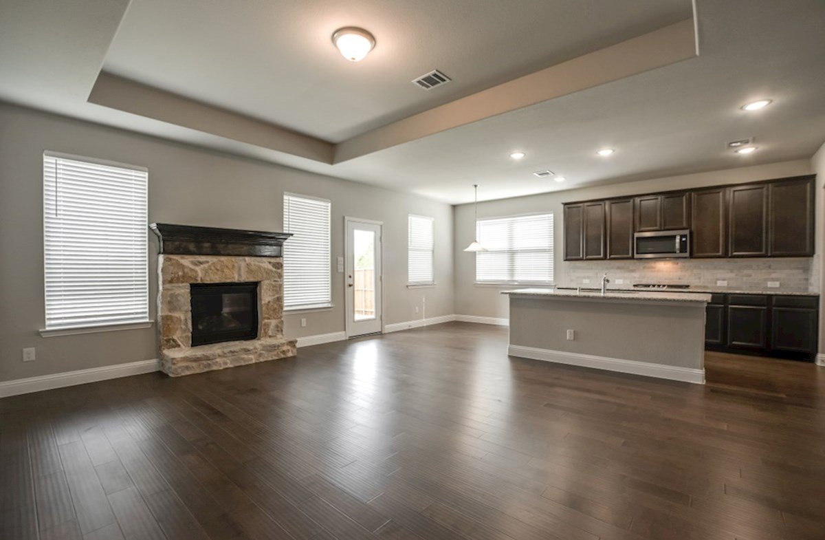 Avalon quick move-in great room with cozy stone fireplace
