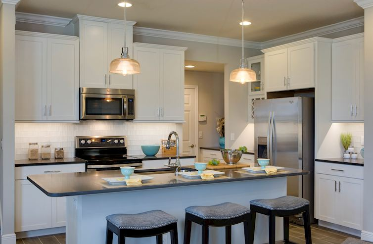 Long Lake Ranch Townhomes Erie Kitchen with white cabinets, center island and stainless steel appliances