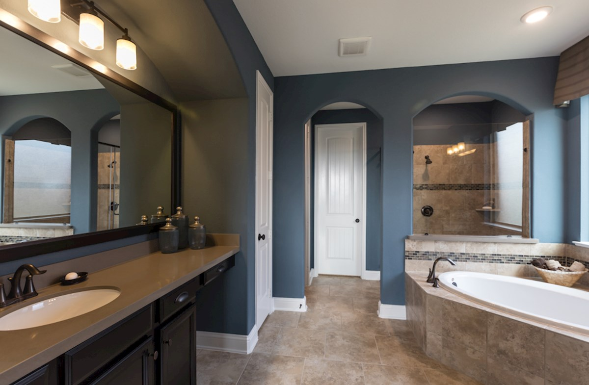 Gruene master bathroom with tile flooring