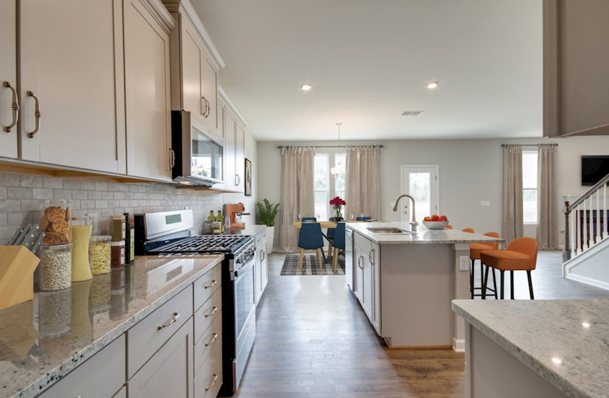 Ashford quick move-in open concept kitchen and dining room with double windows