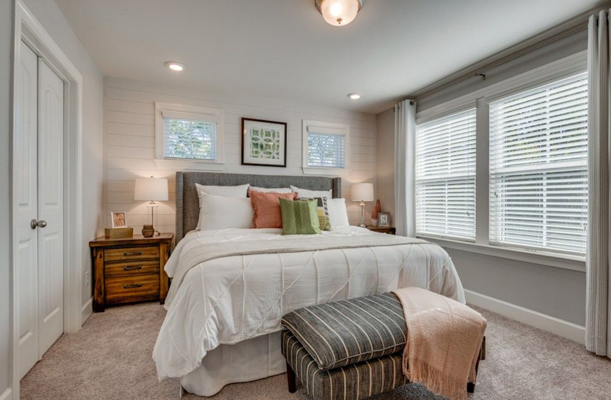 Harpeth Springs Village Jackson master with shiplap accent wall and double windows