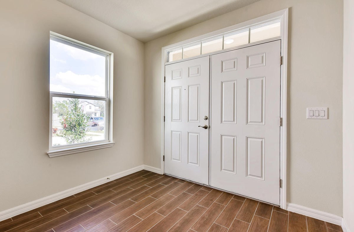 Redington quick move-in Large foyer with wood-look tile and double doors