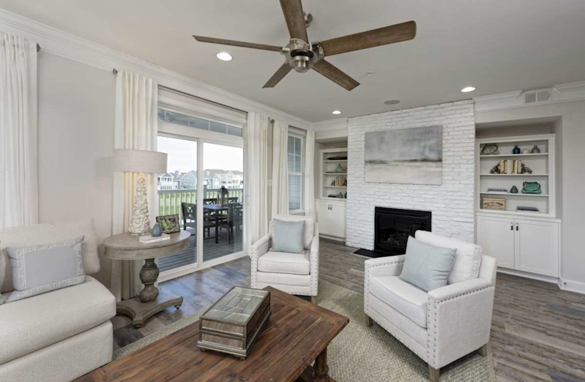 Harbor Crest at Bayside Fenwick Additional family room featuring a fireplace