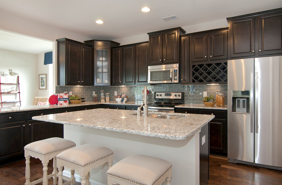 Cameron Village Millbrook kitchen features hardwoods and granite countertops
